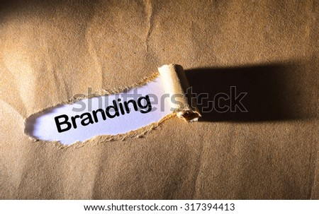 torn paper with word best branding - stock photo