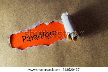 Torn paper with word paradigm - stock photo