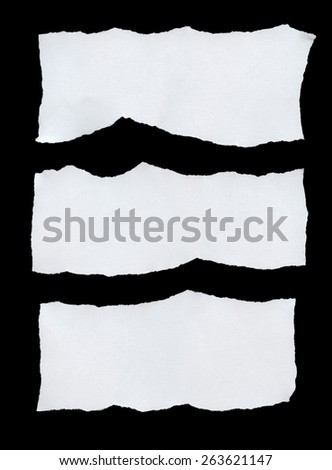 Torn Piece of White Paper, isolated on black background. - stock photo