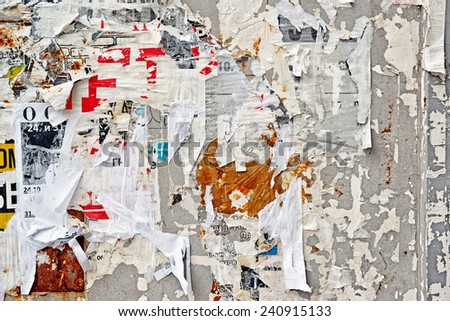 Torn Poster Wall Texture Pattern as Urban Background - stock photo