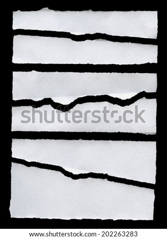 Torn Real Paper On Black Background - stock photo