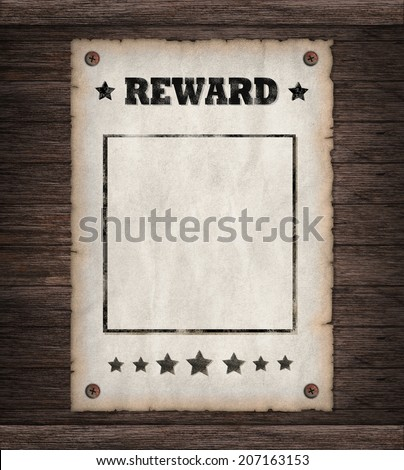 Torn Wild West Reward poster on old wooden wall  - stock photo