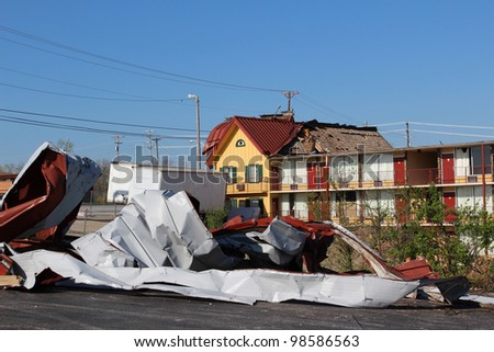 Tornado damage from a late winter storm in is very apparent under clear blue skies. - stock photo