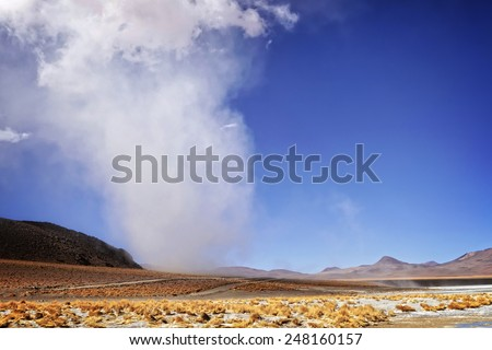 Tornado in good weather conditions moves through the sandy desert - stock photo