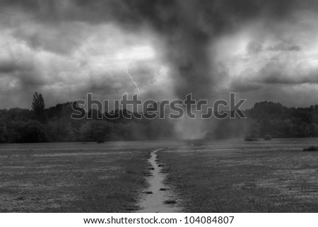 tornado on the road - stock photo