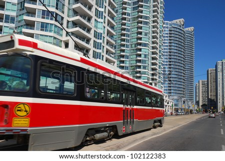Toronto apartment buildings and tram - stock photo