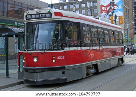 TORONTO - APRIL 22: A Toronto streetcar on April 22, 2012 in Toronto. The Toronto Transit Commission (TTC) operates 11 streetcar lines and 248 streetcars. - stock photo