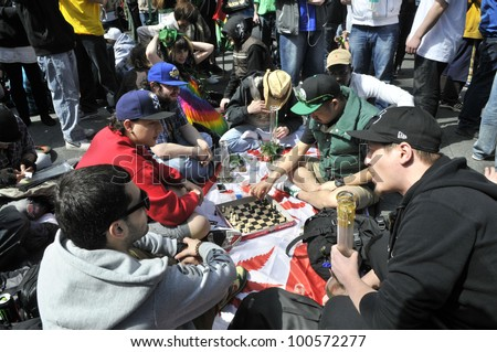 TORONTO - APRIL 20:   Group of marijuana  activists hanging out and playing chess during the annual marijuana 420 event at Yonge & Dundas Square  on April 20  2012 in Toronto, Canada. - stock photo