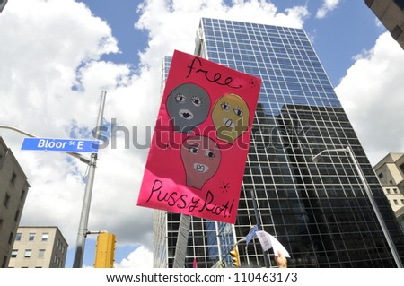 "TORONTO -AUGUST  17:  People raising their banners as a mark of solidarity during a protest rally organized to free ""pussy riot""on August 17 2012 in Toronto, Canada. - stock photo"