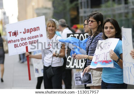 TORONTO-AUGUST 31: Protesters lining up on the sidewalks in downtown during a rally to protest the start of the annual  dolphin hunt at Taiji,Japan on August  31, 2012 in Toronto, Canada. - stock photo