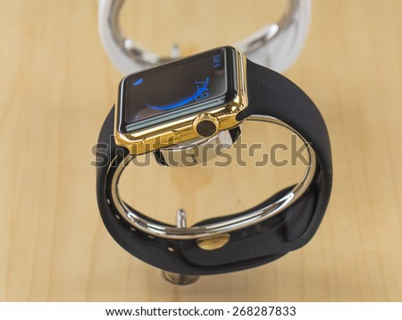 TORONTO, CANADA - APRIL 10, 2015:  A couple of new Apple Watch Edition sit at the retail store. Apple begins the Apple Watch pre-order at the Canadian retail stores this day. - stock photo