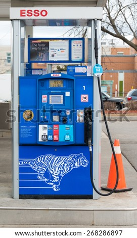 TORONTO,CANADA-APRIL 4: 2015: Esso gas pump in station. Esso is an international trade name for ExxonMobil The name is a phonetic version of the initials of the pre-1911 Standard Oil - stock photo