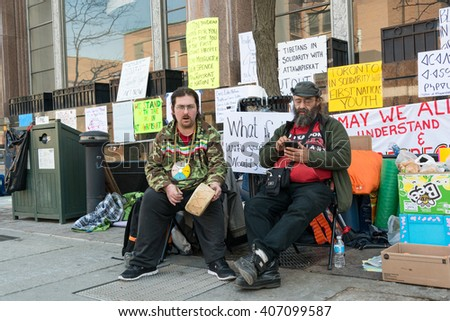 TORONTO,CANADA-APRIL 17,2016: Idle No More, Black Lives Matter protesters occupy the Toronto office Occupation of Indigenous and Northern Affairs of the demand action on Attawapiskat suicide crisis - stock photo