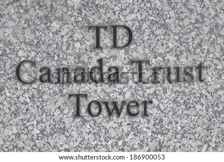 Toronto, Canada - April 7, 2014: TD Canada Trust Tower sign in front of their office building in Toronto's financial district. - stock photo