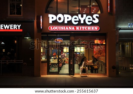 TORONTO, CANADA - AUG 23, 2011.  Popeyes Louisiana Kitchen, also known as Popeyes Chicken, downtown on Yonge Street.  It is a popular American franchise with over 2000 stores in over 22 countries.   - stock photo