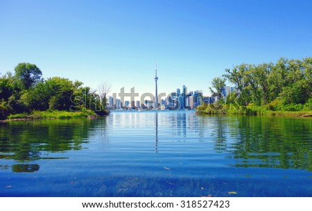 TORONTO, CANADA - AUGUST 9, 2015: A view of the CN Tower and the skyline from the Toronto Island, Canada. - stock photo