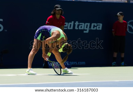 TORONTO, CANADA - AUGUST 12 :  Ana Ivanovic in action at the 2015 Rogers Cup WTA Premier 5 tennis tournament - stock photo
