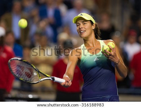 TORONTO, CANADA - AUGUST 13 :  Ana Ivanovic whacks balls into the crowd following her third-round match at the 2015 Rogers Cup WTA Premier 5 tennis tournament - stock photo