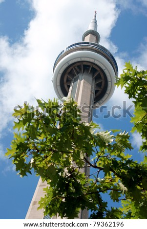 TORONTO, CANADA - AUGUST 1: CN Tower on August 1, 2008 in Toronto, Canada. It is one of the symbols of Canada with its 553.33 meters (1,815.4 ft) height. This is a communications and observation tower. - stock photo