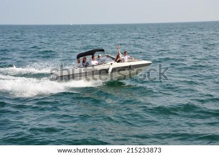 Toronto, Canada - August 2, 2014: Family enjoying boating at Lake Ontario in Toronto, Canada. - stock photo