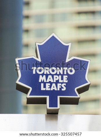 TORONTO,CANADA-AUGUST 12,2015: The Toronto Maple Leafs is a professional ice hockey team based in Toronto.Emblem of  ice hockey team. - stock photo