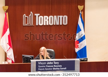 TORONTO,CANADA-DECEMBER 9,2015: Frances Nunziata, speaker of the Toronto Council, working while the taxi drivers protestors against UberX were observing the deliverations in the Municipal Government - stock photo