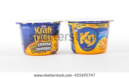 TORONTO, CANADA - FEBRUARY 9, 2016 : Kraft Dinner Macaroni and Cheese Personal Portions in an illustrative editorial on bright background - stock photo