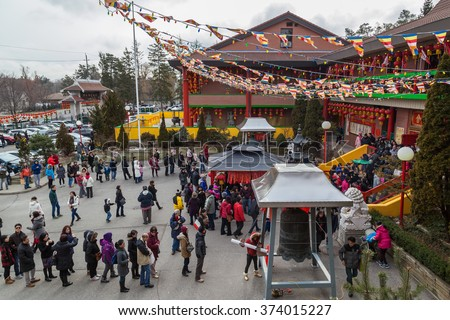 TORONTO, CANADA - February 08, 2016: Peoples worshiping in Cham Shan Temple on Chinese New Year Cham Shan is the oldest Chinese Buddhist temple in Toronto.  - stock photo