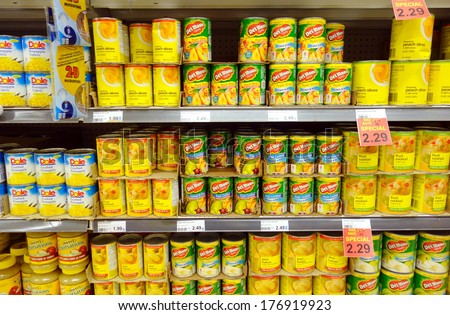 TORONTO, CANADA - JANUARY 31, 2014: Canned fruit cans in a supermarket in Toronto, Canada. - stock photo