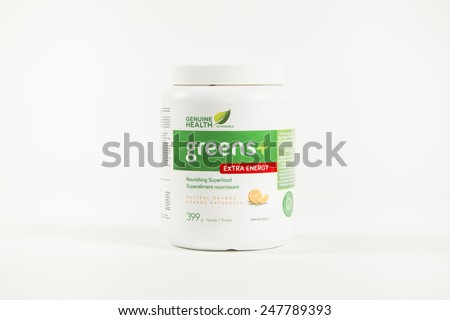Toronto, Canada - January 27 2015 : Container of Greens+ Greens Powder of the Extra Energy Variety, produced by Genuine Health and shown on a bright background - stock photo