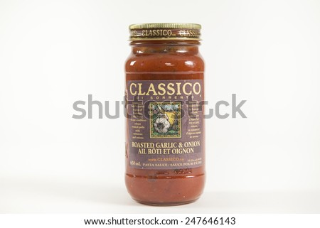 Toronto, Canada - January 27 2015 : Glass Jar of Classico Brand Tomato Sauce with a Roasted Garlic and Onion Flavor, Classico is Heinz Company Brand specializing in Tomato Sauces - stock photo