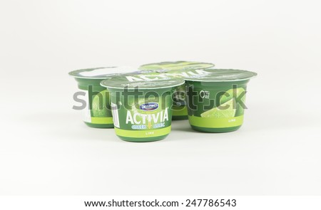 Toronto, Canada - January 27 2015 : Individual Portion Cups of Activia Probiotic Greek Yogurt with a Lime Flavor on a bright background - stock photo