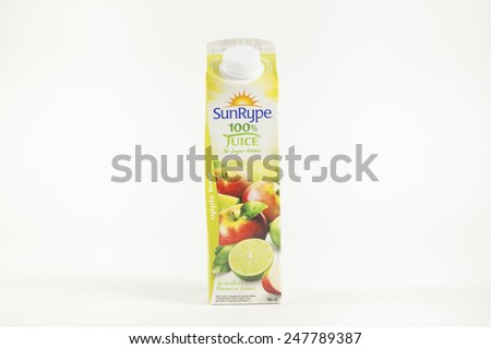 Toronto, Canada - January 27 2015 : One Litre of Sun Rype brand Apple-Lime flavoured apple juice shown on a bright background - stock photo