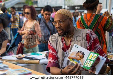 TORONTO,CANADA-JULY 1,2016:Canada Day people: Jamaican or Afro Caribbean people vendors in Dundas Square.Canada Day  is the national day of Canada and a federal statutory holiday - stock photo