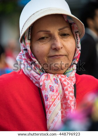 TORONTO,CANADA-JULY 1,2016:Canada Day people: muslim woman wearing niqab and enjoying the music at Dundas Square..Canada Day  is the national day of Canada and a federal statutory holiday - stock photo