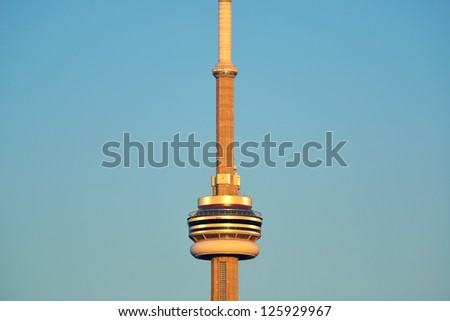 TORONTO, CANADA - JULY 2: CN Tower closeup on July 2, 2012 in Toronto. Buit in 1976 as the unique landmark of Toronto, it was world's tallest tower for 34 years - stock photo