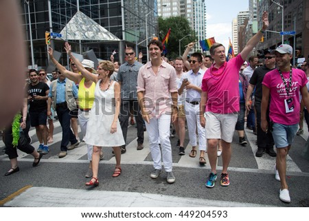 TORONTO,CANADA-JULY 3,2016: Justin Trudeau, Kathleen Wynne and John Tory (three levels of Canadian Government) march for the first time ever in 36th Pride Parade - stock photo