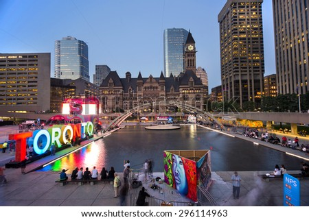 TORONTO,CANADA-JULY 9,2015: Panoramic view of the new Toronto sign in Nathan Phillips Square, host of PanaMania, a constant party celebrating the PanAm games. Old City Hall in the back. - stock photo