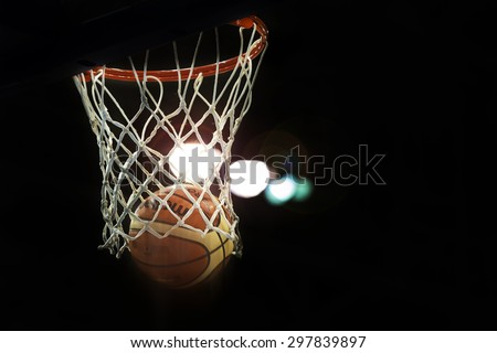 TORONTO,CANADA-JULY 16,2015: Toronto Pan American Games 2015: Official Molten basketball scoring two points in a high dynamic range scene with back light.  - stock photo