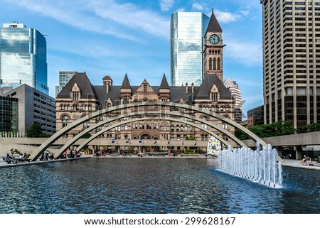 TORONTO, CANADA - 23 JULY, 2014: Toronto's Old City Hall (architect Edward James Lennox, 1899) was home to its city council from 1899 to 1966 and remains one of the city's most prominent structures. - stock photo