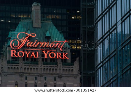 TORONTO,CANADA-JUNE 20,2015:Fairmont Royal York sign on the roof at night. The Fairmont Royal York Hotel is a large and historic hotel in downtown  - stock photo