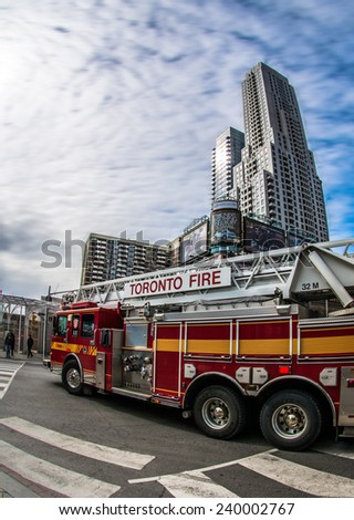 TORONTO,CANADA-JUNE 20,2013: Fire truck rushing to an alarm in the city. Toronto city reports about 300 fire alarms on a daily basis so it is common to see firetrucks and ambulances rushing out. - stock photo