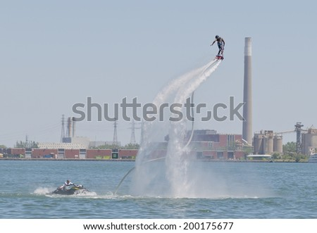 Toronto, Canada - June 22, 2014 : The world's newest extreme water sport call flyboarding at the 2014 Flyboard North American Championships happening at Harbour Square Park.  - stock photo