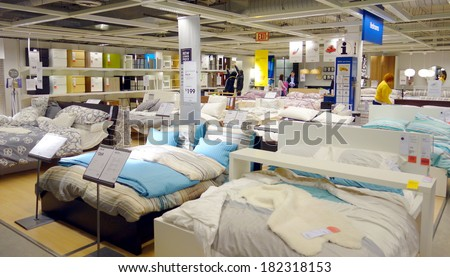 TORONTO, CANADA - MARCH 1, 2014: Bedroom furniture on display at an Ikea store in Toronto, Canada. Founded in Sweden in 1943, Ikea is the world's largest furniture retailer. - stock photo