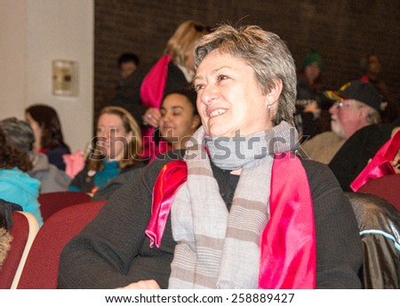 TORONTO,CANADA-MARCH 8,2015: Janet David, councillor.Thousands gathered in Toronto to mark International Women Day IWD with a protest march demanding improvements in many social issues. - stock photo