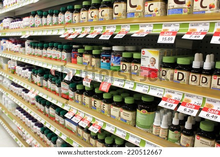 TORONTO, CANADA - MAY 07, 2014: Different types of vitamins and supplements on shelves in a pharmacy. According to studies, North America and Asia lead vitamin and supplement usage in the world. - stock photo