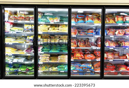 TORONTO, CANADA - MAY 06, 2014: Frozen foods on shelves in a supermarket. In North America, consumption of frozen food has increased in recent years, mostly due to people's busy lifestyle. - stock photo