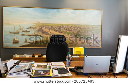 TORONTO,CANADA-MAY 24,2015: Inside the Toronto Mayor's Office during John Tory government, the working desk with publications and electronic devices. - stock photo