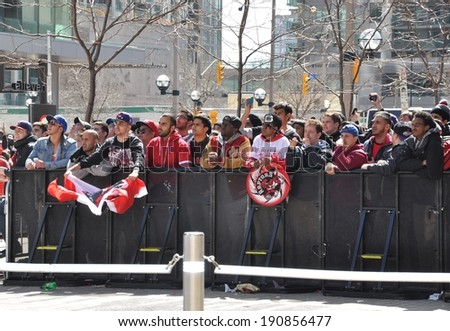 Toronto, Canada - May 4, 2014: Toronto Raptors fans gathered at Maple Leaf Square to watch in giant  screen the do or die games in playoffs of their team vs. Brooklyn Nets. Nets won 104-103. - stock photo