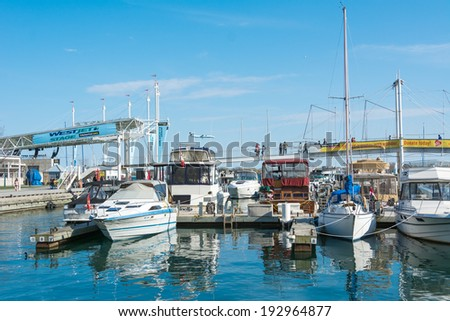 TORONTO,CANADA-MAY 11, 2014: Water related activities in Mother's Day in the Harbourfront.The Harbourfront is a neighbourhood on the northern shore of Lake Ontario within the downtown core of the city - stock photo